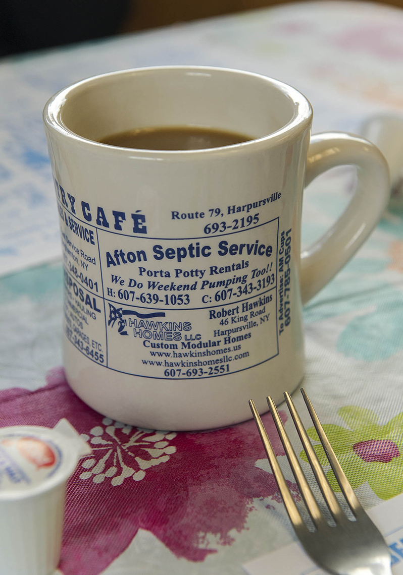 PAR_PhotoReporters_coffee-mug-ad-for-septic-service-at-Grammas-Country-Cafe_Harpursville_NY