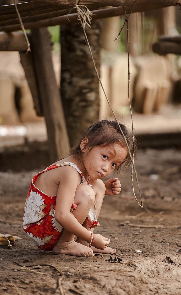 TRA_PhotoReporters_Girl-plays-in-her-village_Luang-Prabang_Laos